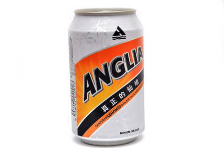 non alcoholic beverage: SINGAPORE- MAR 15: An isolated Anglia Shandy on the white background on March 15, 2015.  Anglia Shandy is a Low Alcohol beer by Guinness Anchor Berhad