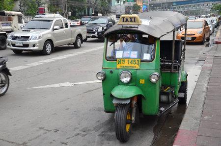 BANGKOK, THAILAND - MAR 29: Traditional street taxi tuk-tuk awaits passengers on a street in Chinatown in Bangkok on 29 March 2015. In Bangkok, there are more than 100,000 tuk-tuk.