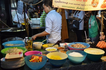 ubiquitous: BANGKOK, THAILAND - MAR 27. An unidentified street vendor cooks pad thai on March 27, 2015 in Bangkok, Thailand. Street cooking is a tradition and ubiquitous in Thailand.
