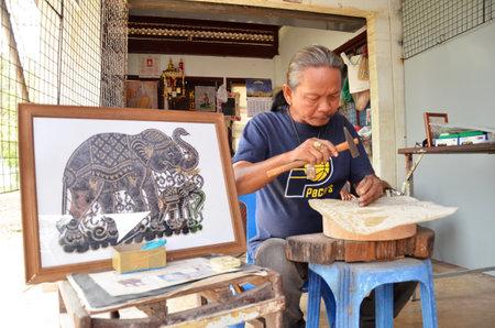 sales person: AYUTTHAYA, THAILAND -MAR 26: Artist creates the hand craft by using buffalo skin in Ayutthaya, Thailand on March 26, 2015.