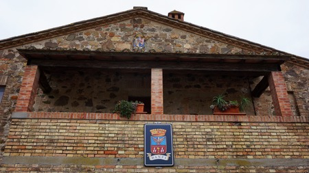 top 7: MONTALCINO, ITALY- DEC 23: Logo of Castillo Banfi  on the wall of old castle in Montalcino, Italy on December 23, 2014. Castillo Banfi is situated at the top of a hill overlooking the expansive 7,000 acre Banfi estate.