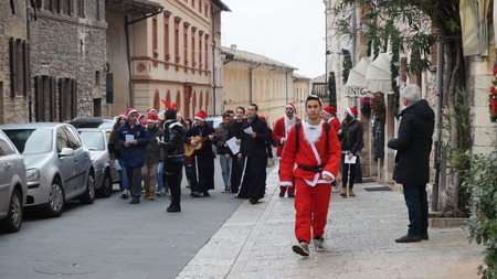 disadvantaged: MILAN, ITALY - DEC 18, 2014: People dress as Santa play in Milan, Italy. Their purpose is to raise funds for needy and disadvantaged children. Editorial