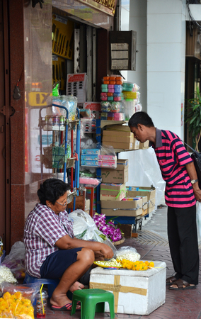 BANGKOK, THAILAND- MAR 25: Street vendors are waiting for customers on the street in Chinatown, Bangkok on 25 March, 2015. According gov stats there are over 16,000 registered street vendors in Bangkok.