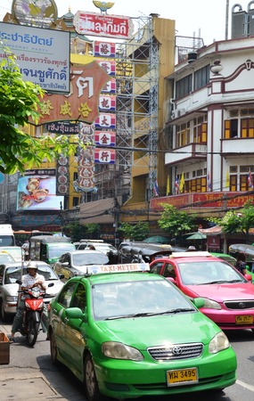 however: BANGKOK - MARCH 31, 2015 : Colorful Bangkok taxi on the street in Bangkok. Public transport develops rapidly in Bangkok, however traffic congestion is still a problem.