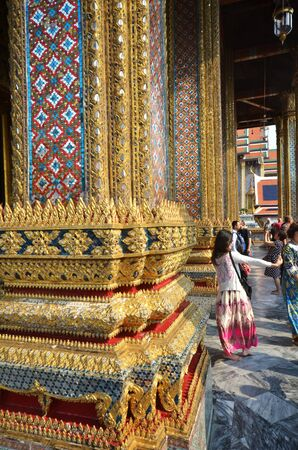 knew: BANGKOK, THAILAND - MAR 26 , 2015: Tourists vist the Grand Palace in Bangkok, Thailand on March 26 2015. Grand Palace in Bangkok is the most famous temple and landmark of Thailand. Editorial