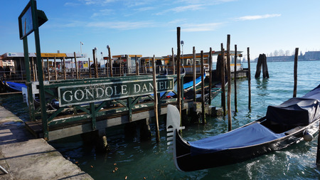 gondoliers: VENICE, ITALY-DEC 22 : Venetian gondoliers await some tourists to carry around on a gondola in Venice on December 22,2014. Venice is a special city in Italy,built in a lagoon and it has many canals