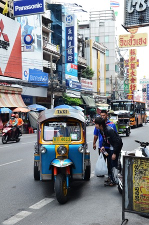 mototaxi: BANGKOK, THAILAND - MAR 27: Tuk-tuk moto taxi on the street in the Chinatown area on March 27, 2015 in Bangkok. Famous bangkok moto-taxi called tuk-tuk is a landmark of the city and popular transport. Editorial
