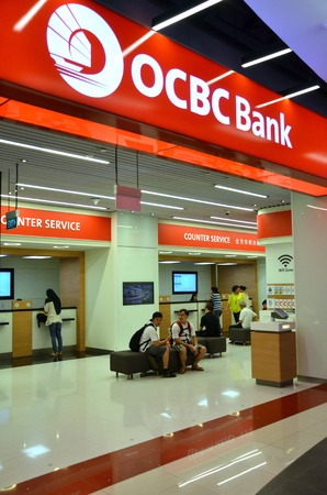 oversea: SINGAPORE - 18 APR: Customers is waiting to be served in OCBC Bank in Singapore on 18 Aprl, 2015. OCBC oversea Chinese Banking Corporation is a financial services organisation based in Singapore. Editorial