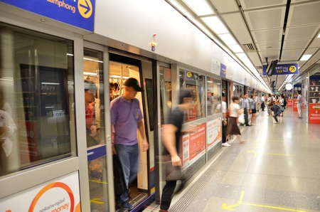 BANGKOK THAILAND - MAR 27: Passengers wait for train in a Metropolitan Rapid Transit (MRT) subway train station on March 27 2015 in Bangkok. Thailand. The MRT serves 240000 people daily with 18 stations and 27 km of track.