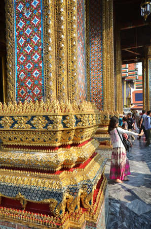 knew: BANGKOK THAILAND - MAR 26 2015: Tourists vist the Grand Palace in Bangkok Thailand on March 26 2015. Grand Palace in Bangkok is the most famous temple and landmark of Thailand. Editorial