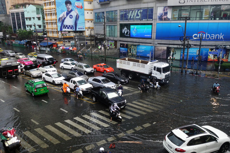 downpour: BANGKOK, THAILAND-MAR 24: Heavy downpour in inner Bangkok has caused floods on several roads and traffic jams on March 24, 2015.