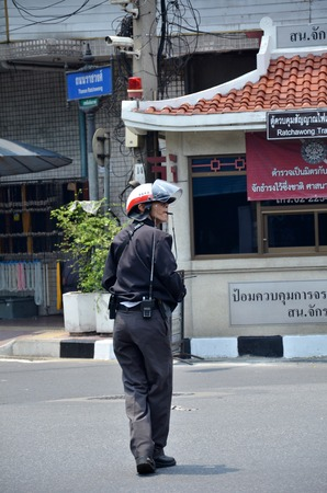 the worst: THAILAND, ANGKOK - MAR 27: Traffic police gives direction to traffic on the road in Bangkok on March 27, 2015. Traffic condition in Bangkok is one of the worst in the world.