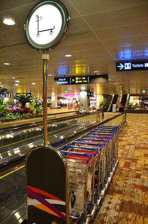 SINGAPORE - MAR 25: Baggage Carts in Changi Airport, Singapore on March 25, 2015. Changi Airport, is the main airport in Singapore. A major aviation hub in Southeast Asia