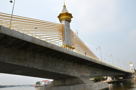 with ease: BANGKOK-MAR 26: View of newly built Nonthaburi 1 Bridge in Bangkok on March 26, 2015. The six-lane, 4.3km Nonthaburi 1 Bridge will help ease traffic in Nonthaburi.