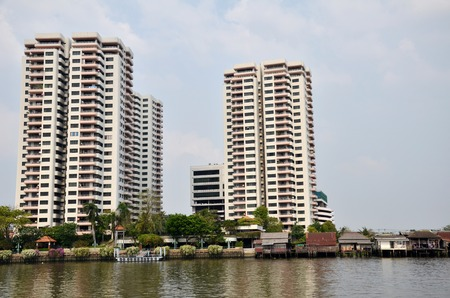 chao phraya river: BANGKOK- MAR 26: Luxury condominiom is built along the Chao Phraya river in Bangkok on March 26, 2015. More and more property developers had introduced condominium projects along the Chao Phraya River
