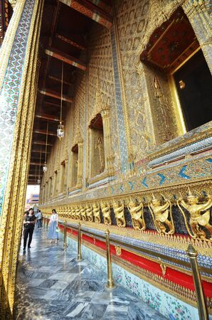 knew: BANGKOK, THAILAND - MAR 26, 2015: Tourists visit the Grand Palace in Bangkok, Thailand on March 26 2015. Grand Palace in Bangkok is the most famous temple and landmark of Thailand.