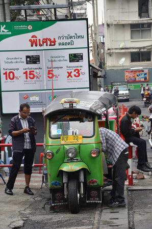 amasing: BANGKOK THAILAND - MAR 29: Traditional street taxi tuk-tuk awaits passengers on a street in Chinatown in Bangkok on 29 March 2015. In Bangkok there are more than 100000 tuk-tuk.