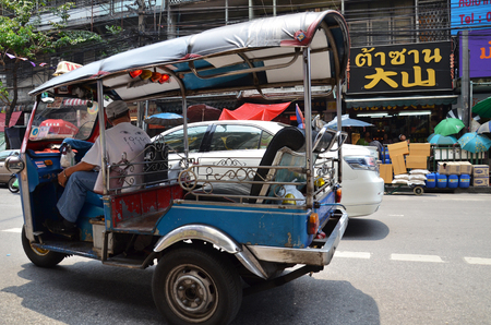 auto rickshaw: BANGKOK, THAILAND - MAR 27: Tuk-tuk moto taxi on the street in the Chinatown area on March 27, 2015 in Bangkok. Famous bangkok moto-taxi called tuk-tuk is a landmark of the city and popular transport. Editorial