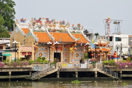 chao phraya river: BANGKOK, THAILAND-MAR 26: Traditional Chinese temple on embankment of Chao Phraya river on March 26, 2015 in Bangkok. The population of Bangkok - capital in 2009 was 6,202 million.