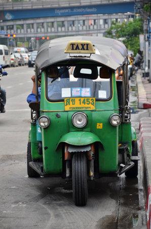 BANGKOK THAILAND - MAR 29: Traditional street taxi tuk-tuk awaits passengers on a street in Chinatown in Bangkok on 29 March 2015. In Bangkok there are more than 100000 tuk-tuk.