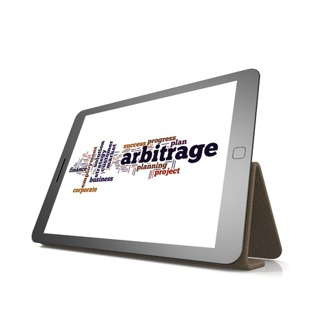 trading board: Arbitrage word cloud on tablet image with hi-res rendered artwork that could be used for any graphic design. Stock Photo