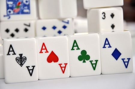 Mahjong set with four Aces in the front view photo