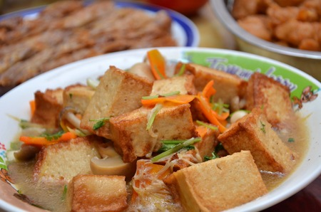 Chinese gourmet, tasty fried bean curd cooks with vegetable photo