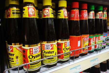 shelve: KUALA LUMPUR, MALAYSIA - JUNE 15 2015: Various of oyster sauce sold on the market . Oyster sauce is a important ingredient for oriental dishes.