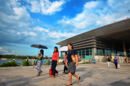 barrage: SINGAPORE - MAY 31: Peoples visit Marina Barrage, Singapore on May 31, 2015. Marina Barrage is a government-commissioned dam built across the mouth of Marina Channel