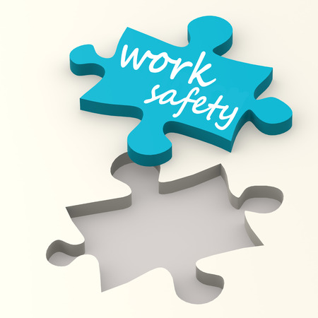 safety first: Work safety on blue puzzle image with hi-res rendered artwork that could be used for any graphic design.
