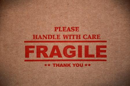label tag: Fragile warning sign label tag on a cardboard box packet parcel