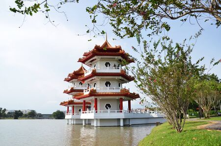 chinese garden: SINGAPORE- JUL 21: Tourists visit the Twin Pagoda at the Chinese Garden of Singapore on July 21, 2015. The Chinese Gardens concept is based on Chinese gardening art. Editorial