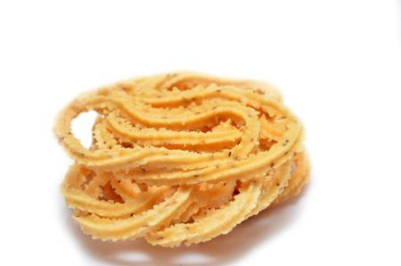 muruku: Traditional Indian Diwali snacks Chakali, isolated on white.