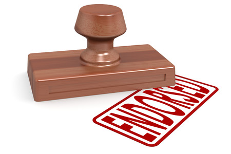 endorsed: Wooden stamp endorsed with red text image with hi-res rendered artwork that could be used for any graphic design. Stock Photo