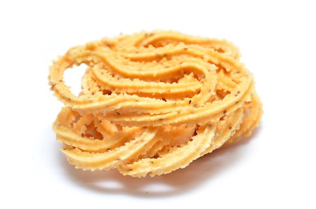 traditional food: Traditional Indian Diwali snacks Chakali, isolated on white.