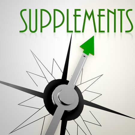 suitability: Supplements on green compass. Concept of healthy lifestyle Stock Photo