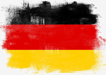 Flag of Germany painted with brush on solid background,