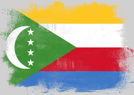 history month: Flag of Comoros painted with brush on solid background,