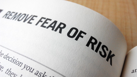 fear: Fear of risk word on a book. Business success concept