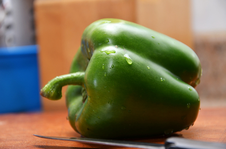 cleave: Sweet chili and knife on wooden cutting boards