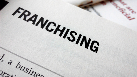franchising: Franchising word on a book. Business success concept