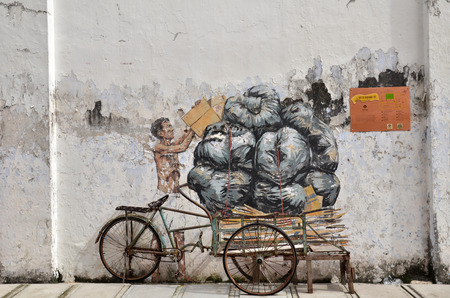 IPOH, MALAYSIA - 25 NOV 2015: Trishaw painted by Ernest Zacharevic in Ipoh.