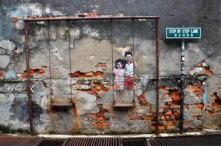 conjunction: PENANG, MALAYSIA - NOV 26, 2015: Street Mural tittle Children on the Swing painted by Louis Gan in Penang. It was painted in conjunction with the 2012 George Town Festival