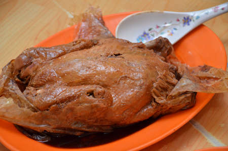 favorite colour: Beggar chicken served in restaurant in Malaysia Stock Photo