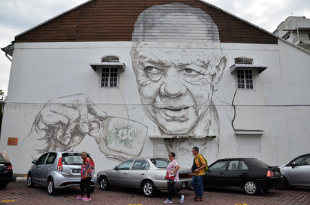 IPOH, MALAYSIA - 25 NOV 2015: Old Man Drinking White Coffee painted by Ernest Zacharevic in Ipoh.