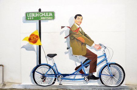 PENANG, MALAYSIA - NOV 26, 2015:  A mural of the famous Mr. Bean character on a bicycle found at the wall along the alley in Chulia Street, George Town. Penang