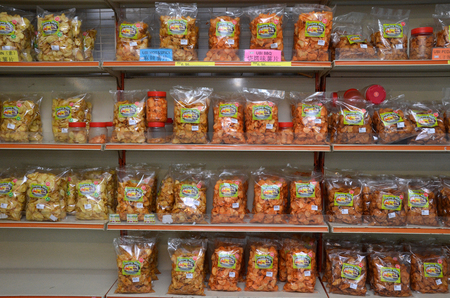 retain: PENANG, MALAYSIA- 26 NOV,2015: Variety Malaysian traditional delicacies in commercial packaging sell in retain store in Penang Editorial
