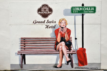 malaysia culture: PENANG, MALAYSIA - 26 NOV, 2015:  Painting of Marilyn Monroe check in Grand Swiss Hotel in Penang, Malaysia. Grand Swiss Hotel is located in George Town, center of Penang.