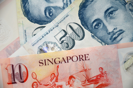 profiting: Detail of Singapore banknotes , fifty dollar and ten dollar notes