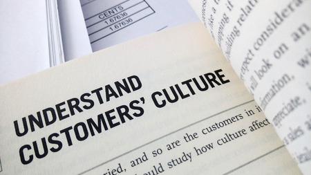 sheet: Understand customer culture word on the book with balance sheet as background